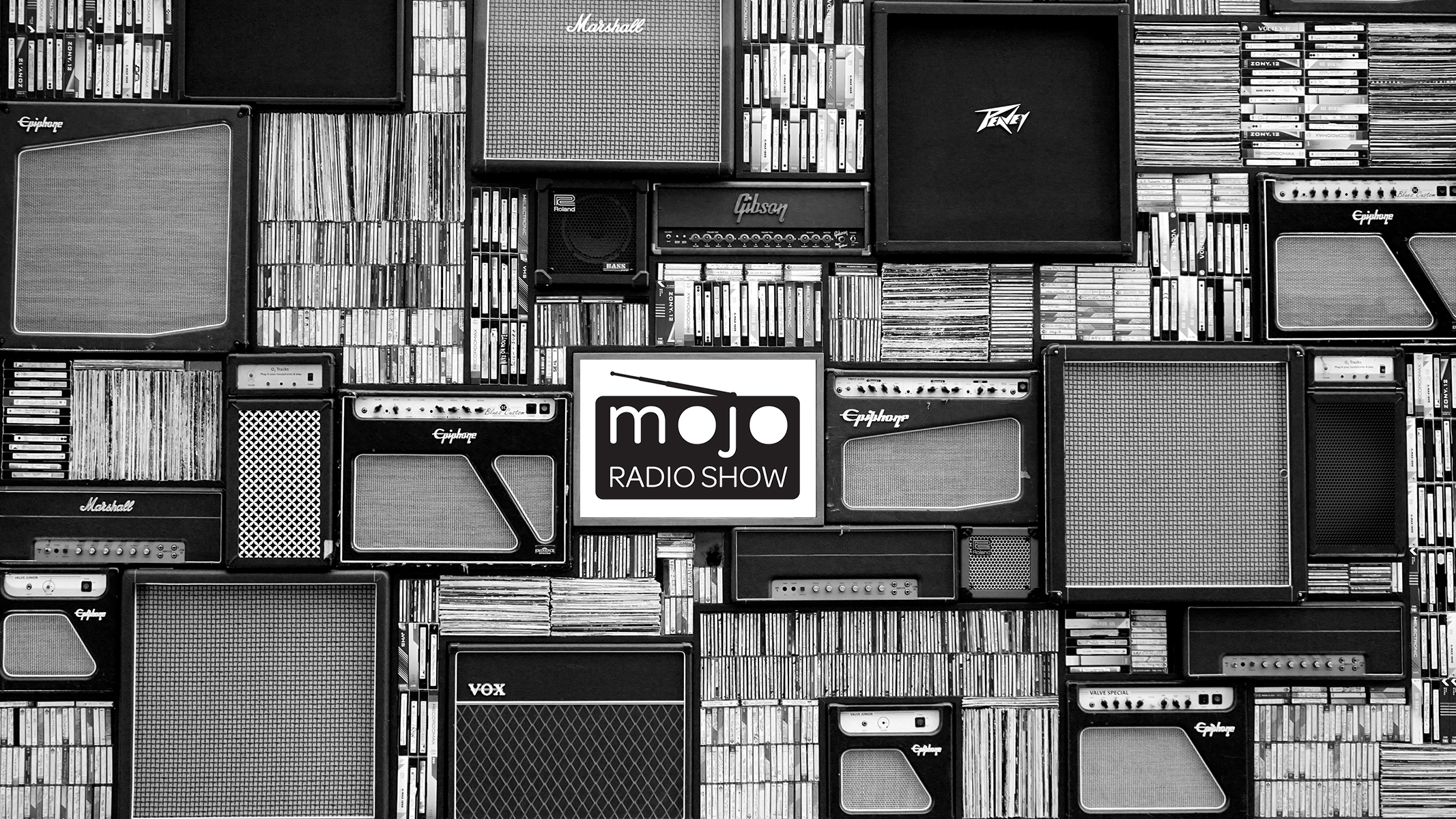 Stacked amps, records, CDs and Mojo Radio Show logo